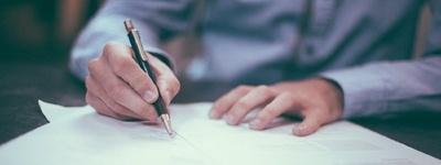 La signature des statuts de la SARL